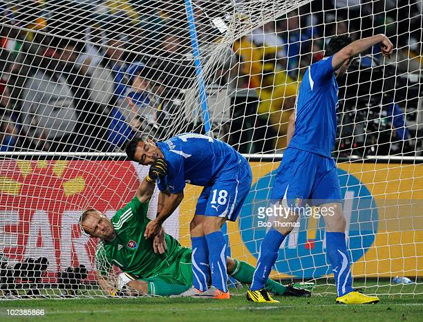 Fabio Quagliarella of Italy trys to get the ball from goalkeeper Jan Mucha of Slovakia during the 2010 FIFA World Cup South Africa Group F match...