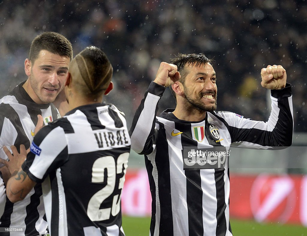 Fabio Quagliarella of Juventus (R) celebrates scoring the second goal during the Champions League round of 16 second leg match between Juventus and Celtic at Juventus Arena on March 6, 2013 in Turin, Italy.