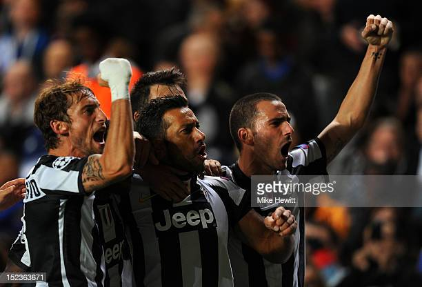 Fabio Quagliarella of Juventus celebrates scoring their second goal with team mates during the UEFA Champions League Group E match between Chelsea...