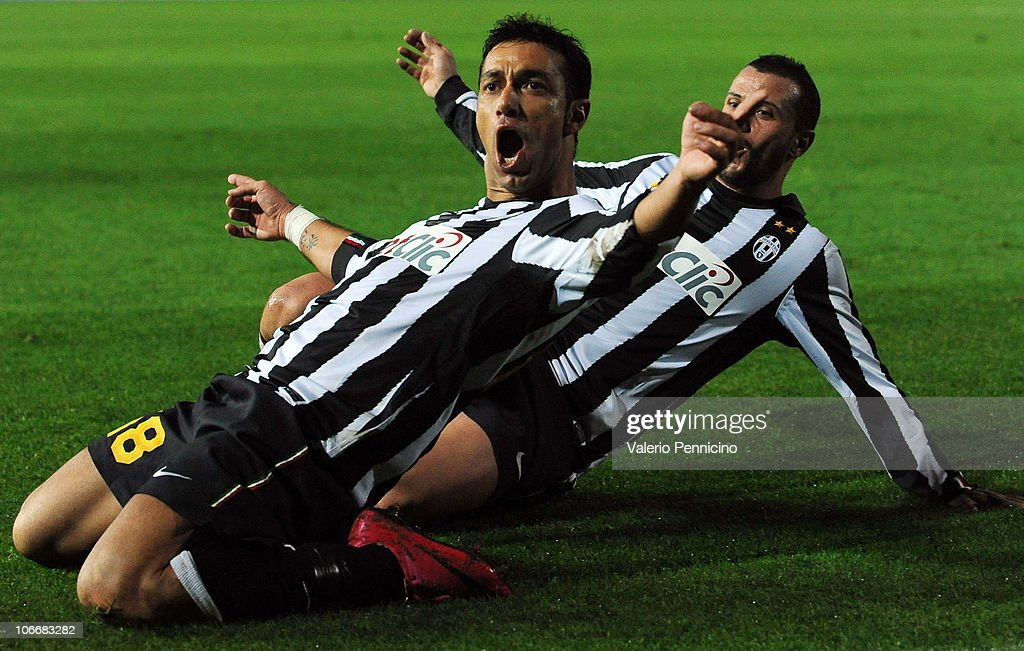 <a gi-track='captionPersonalityLinkClicked' href=/galleries/search?phrase=Fabio+Quagliarella&family=editorial&specificpeople=864022 ng-click='$event.stopPropagation()'>Fabio Quagliarella</a> (L) of Juventus FC after scoring the opening goal during the Serie A match between Brescia Calcio and Juventus FC at Mario Rigamonti Stadium on November 10, 2010 in Brescia, Italy.
