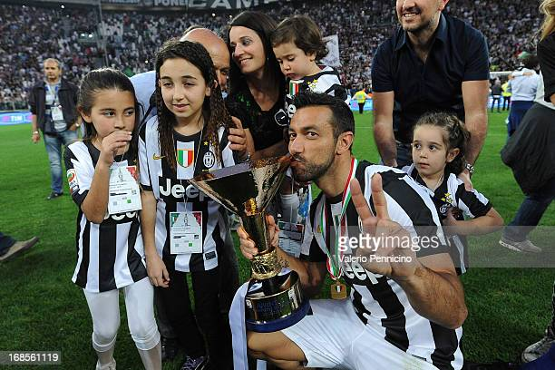 Fabio Quagliarella of Juventus FC celebrates with the Serie A trophy at the end of the Serie A match between Juventus and Cagliari Calcio at Juventus...