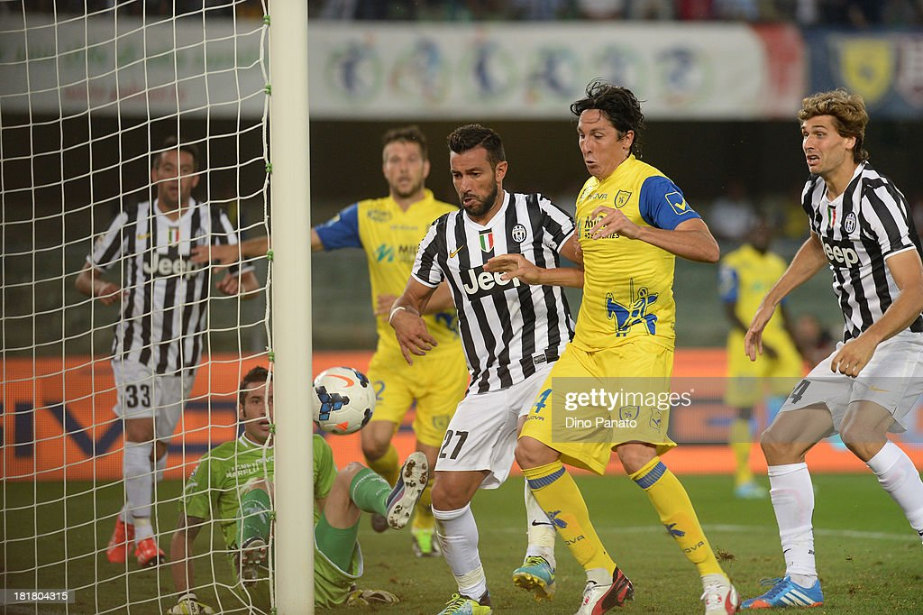 <a gi-track='captionPersonalityLinkClicked' href=/galleries/search?phrase=Fabio+Quagliarella&family=editorial&specificpeople=864022 ng-click='$event.stopPropagation()'>Fabio Quagliarella</a> (C) of Juventus scores his first goal during the Serie A match between AC Chievo Verona and Juventus at Stadio Marc'Antonio Bentegodi on September 25, 2013 in Verona, Italy.