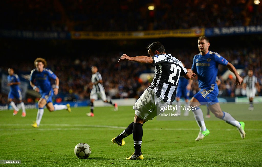 <a gi-track='captionPersonalityLinkClicked' href=/galleries/search?phrase=Fabio+Quagliarella&family=editorial&specificpeople=864022 ng-click='$event.stopPropagation()'>Fabio Quagliarella</a> of Juventus scores their second goal during the UEFA Champions League Group E match between Chelsea and Juventus at Stamford Bridge on September 19, 2012 in London, England.