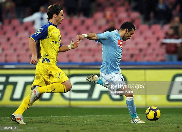 Fabio Quagliarella of Napoli shoots to score the 20 goal during the Serie A match between SSC Napoli and AC Chievo Verona at Stadio San Paolo on...