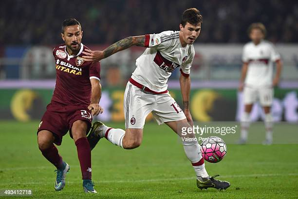 Fabio Quagliarella of Torino FC competes with Alessio Romagnoli of AC Milan during the Serie A match between Torino FC and AC Milan at Stadio...