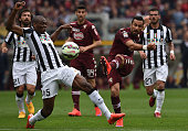 Fabio Quagliarella of Torino FC in action against Angelo Ogbonna of Juventus FC during the Serie A match between Torino FC and Juventus FC at Stadio...