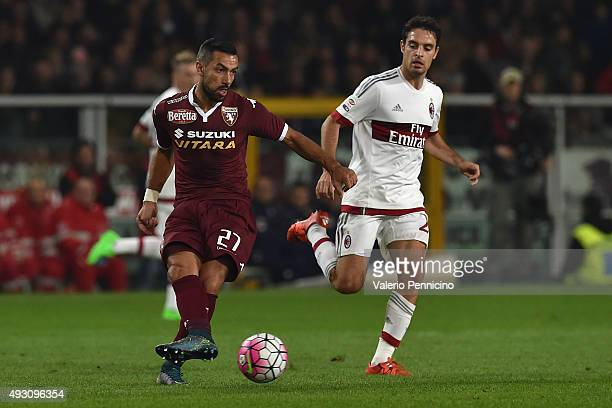 Fabio Quagliarella of Torino FC in action against Giacomo Bonaventura of AC Milan during the Serie A match between Torino FC and AC Milan at Stadio...