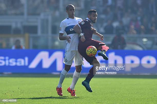 Fabio Quagliarella of Torino FC is challenged by Joao Miranda of FC Internazionale Milano during the Serie A match between Torino FC and FC...