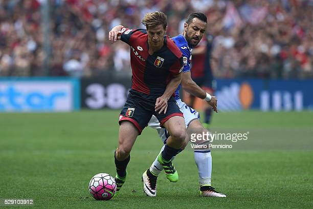 Fabio Quagliarella of UC Sampdoria competes with Cristian Ansaldi of Genoa CFC during the Serie A match between UC Sampdoria and Genoa CFC at Stadio...