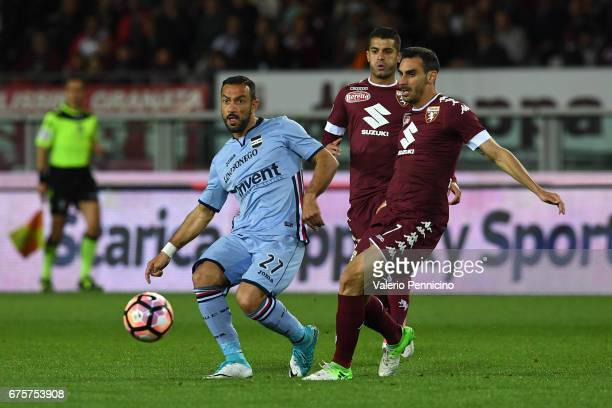 Fabio Quagliarella of UC Sampdoria in action against Davide Zappacosta of FC Torino during the Serie A match between FC Torino and UC Sampdoria at...