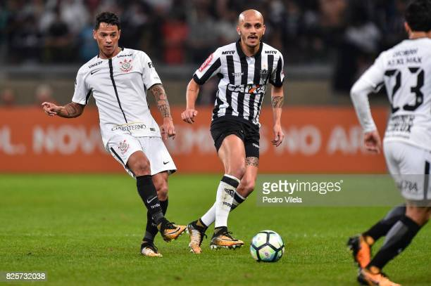 Fabio Santos of Atletico MG and Giovanni Augusto of Corinthians battle for the ball during a match between Atletico MG and Corinthians as part of...