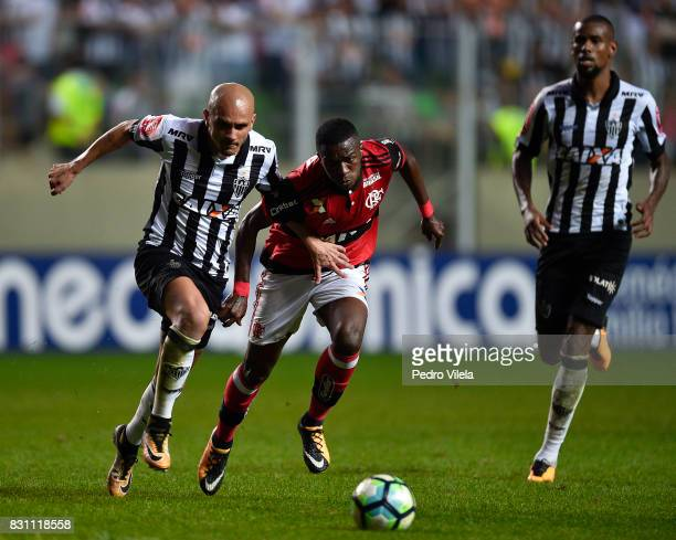 Fabio Santos of Atletico MG and Vinicius Junior of Flamengo battle for the ball during a match between Atletico MG and Flamengo as part of...