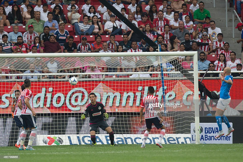 Fabio Santos of Cruz Azul scores the opening goal during a 2nd round match between Chivas and Cruz Azul as part of the Apertura 2015 Liga MX at Omnilife Stadium on August 02, 2015 in Zapopan, Mexico.