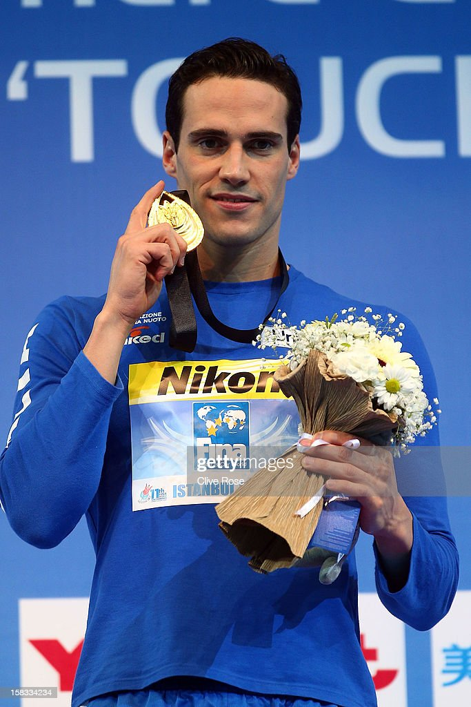 <a gi-track='captionPersonalityLinkClicked' href=/galleries/search?phrase=Fabio+Scozzoli&family=editorial&specificpeople=5966456 ng-click='$event.stopPropagation()'>Fabio Scozzoli</a> of Italy poses with his Gold medal after winning the Men's 100m Breaststroke Final during day two of the 11th FINA Short Course World Championships at the Sinan Erdem Dome on December 13, 2012 in Istanbul, Turkey.