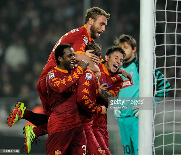 Fabio Simplicio Daniele De Rossi Francesco Totti and Leandro Greco of AS Roma celebrates scoring the first goal during the Serie A match between...
