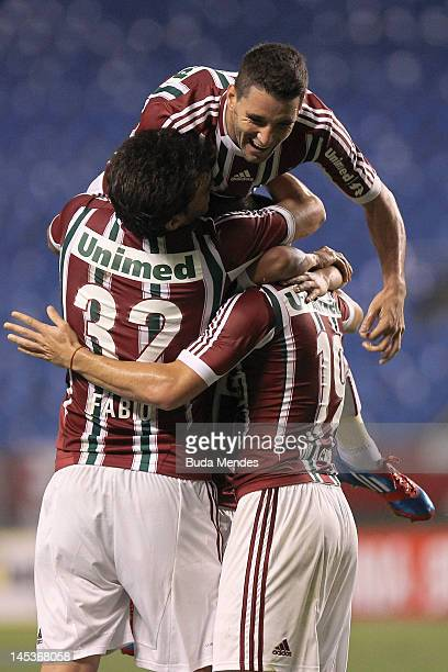 Fabio Thiago Neves and Wagner of Fluminense celebrates a scored goal aganist Figueirense during a match as part of Serie A 2012 at Engenhao stadium...