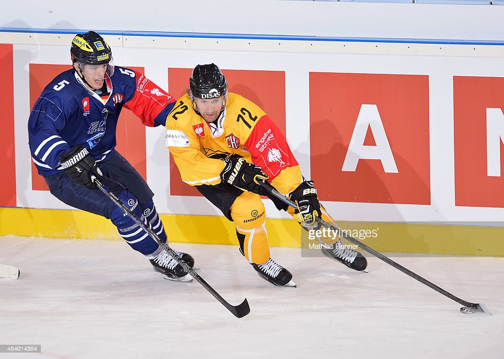 Fabio Wagner #5 of ERC Ingolstadt and Ilmari Pitkanen #72 of SaiPa Lappeenranta fights for the puck during the Champions Hockey League group stage game between ERC Ingolstadt v SaiPa Lappeenranta on August 23, 2014 in Ingolstadt, Germany.