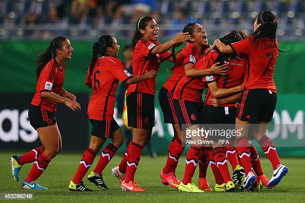 Fabiola Ibarra of Mexico celebrates her team's first goal with team mates during the FIFA U20 Women's World Cup Canada 2014 group C match between...