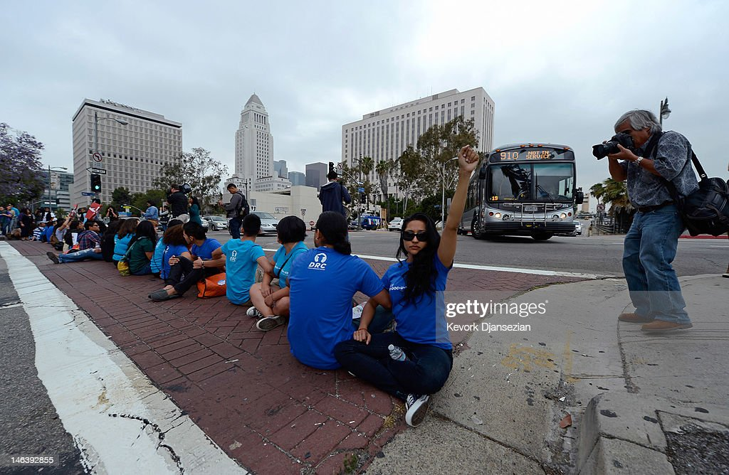 Fabiola Saucedo, 26, and her fellow students block an on ramp to the US101 during a demonstration by immigrant students for an end to deportations and urge relief by governmantel agencies for those in deportation proceedings on June 15, 2012 in Los Angeles, California. In a policy change, the Obama administration said it will stop deporting young illegal immigrants who entered the United States as children if they meet certain requirements.
