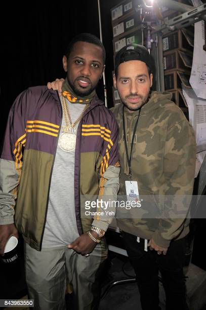 Fabolous and Ronnie Fieg attend Kith Sport fashion show during New York Fashion Week at the Classic Car Club on September 7 2017 in New York City