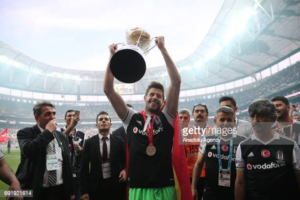 Fabri of Besiktas holds a trophy during the Besiktas' Turkish Super Lig title trophy ceremony at the Vodafone Park in Istanbul Turkey on June 3 2017