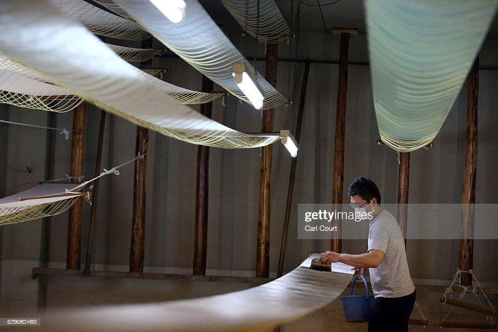 A fabric dye master applies dye to kimono fabric during a stage of its production process at the Sensyo Ichikawa kimono workshop on April 26 2016 in...