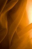 Fabric flows in golden light