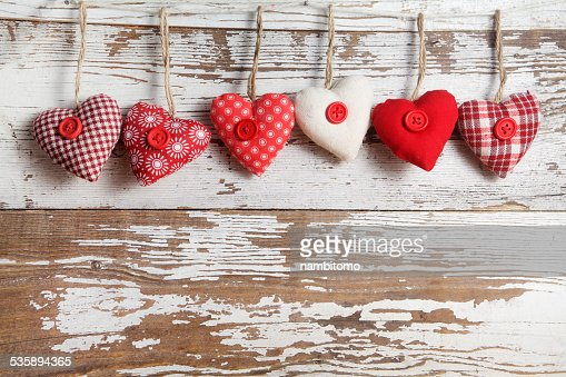 Fabric hearts on a wooden background : Stockfoto