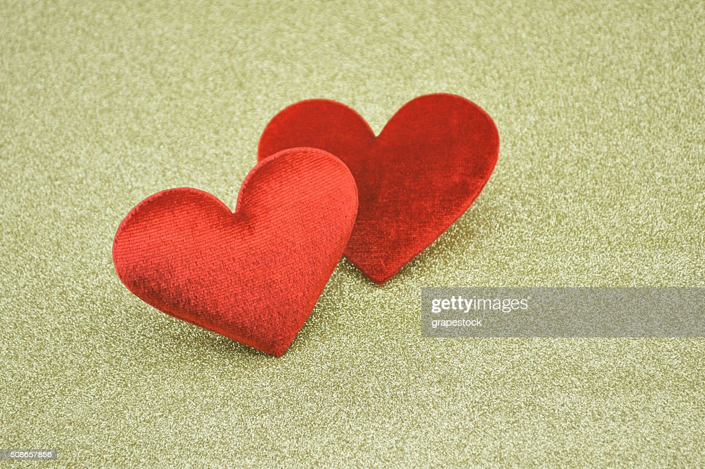 Fabric red heart shape on gold background, Love concept : Stock Photo