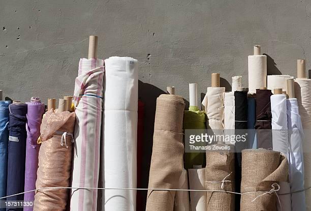 Fabric rolls on a wall