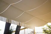 Fabric roof in the form of a beige tent, stock photo