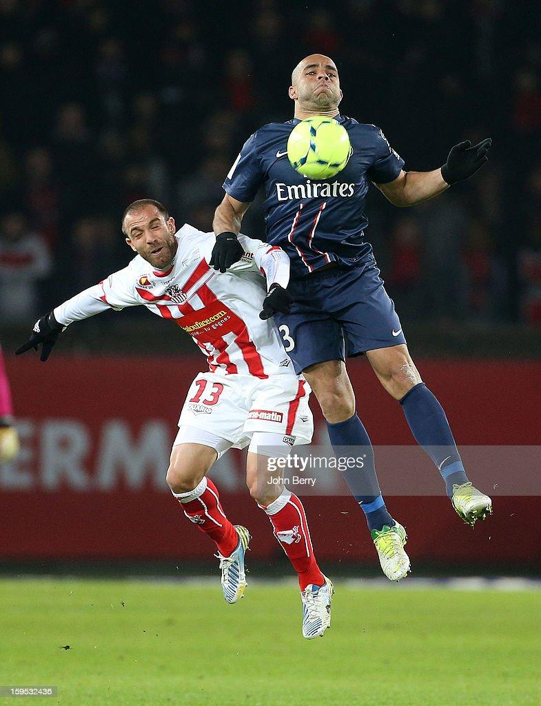 Fabrice Begeorgi of AC Ajaccio and Alex Rodrigo Dias da Costa (R) of PSG in action during the French Ligue 1 match between Paris Saint Germain FC and AC Ajaccio at the Parc des Princes stadium on January 11, 2013 in Paris, France.