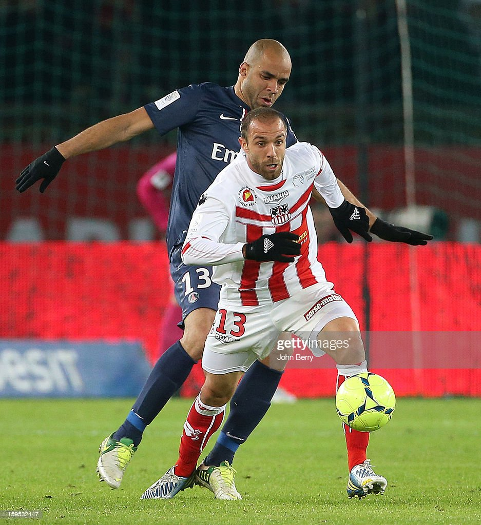Fabrice Begeorgi (R) of AC Ajaccio and Alex Rodrigo Dias da Costa of PSG in action during the French Ligue 1 match between Paris Saint Germain FC and AC Ajaccio at the Parc des Princes stadium on January 11, 2013 in Paris, France.