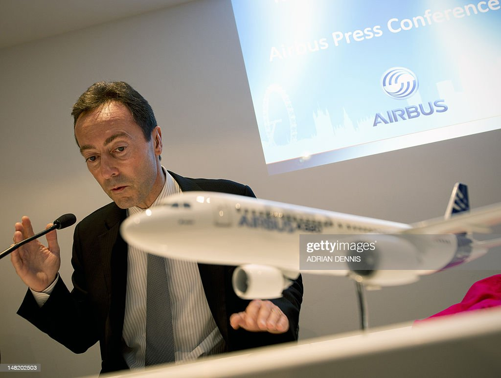 Fabrice Bregier, Airbus President and Chief Executive Officer, turns to look at a projection during a press conference at the Farnborough International Airshow in Hampshire, southern England, on July 12, 2012. Bregier announced Avolon, an international leasing company headquartered in Ireland, announced a memorandum of understanding for 15 Airbus' fuel efficient A320neo aircraft.