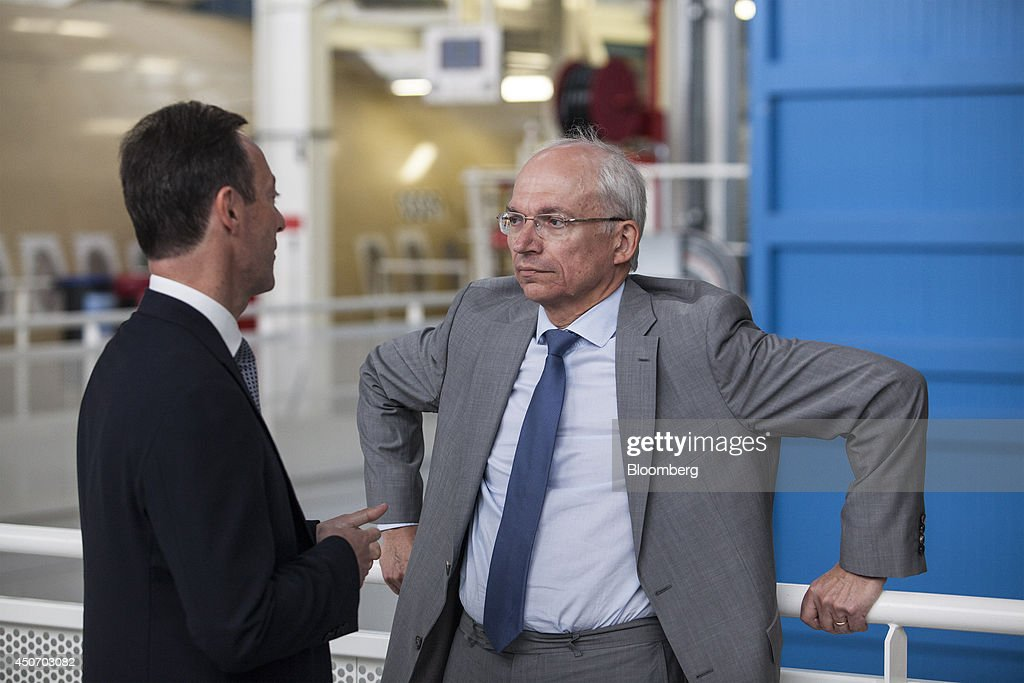 Fabrice Bregier, chief executive officer of Airbus Group NV, left, speaks with Didier Evrard, head of the Airbus Group NV A350 program, during a tour of the Airbus Group NV plant in Toulouse, France, on Monday, June 16, 2014. The current European Union (EU) Commission is an obstacle to the creation of industry champions, French Economy Minister Arnaud Montebourg stated during a visit to Airbus sites in Toulouse, southwest France, today. Photographer: Balint Porneczi/Bloomberg via Getty Images