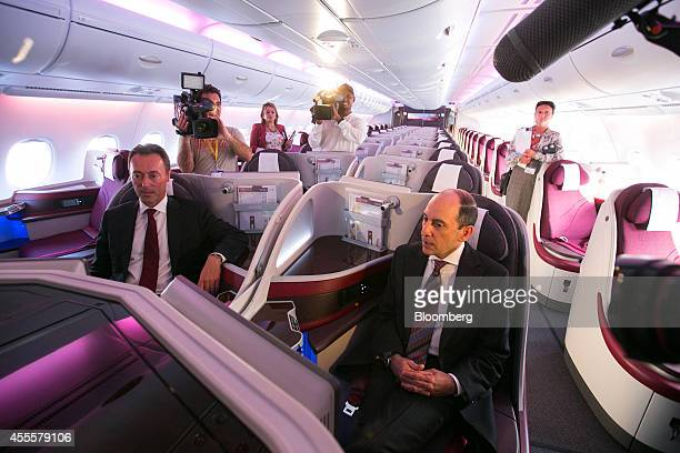 Fabrice Bregier chief executive officer of Airbus left and Akbar Al Baker chief executive officer of Qatar Airways Ltd sit in the business class...