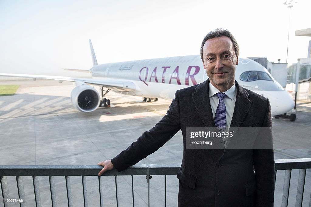 Fabrice Bregier, chief executive officer of Airbus, poses for a photograph as Qatar Airways Ltd.'s first Airbus A350 stands on the tarmac beyond, ahead of a delivery ceremony at the Airbus Group NV factory in Toulouse, France, on Monday, Dec. 22, 2014. Airbus indicated it will bring forward deliveries of its newest A350 model to first customer Qatar Airways while playing down prospects for an early commitment to upgrading its flagship A380 superjumbo. Photographer: Balint Porneczi/Bloomberg via Getty Images