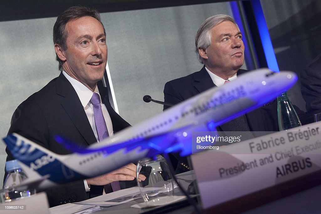 Fabrice Bregier, chief executive officer of Airbus SAS, left, and John Leahy, chief operating officer of Airbus SAS, attend a news conference in Colomiers, France, on Thursday, Jan. 17, 2013. Bregier said he's sticking with a goal of flying the A350 jet mid-year and that it represents 'a lower risk approach' than the Boeing Co. 787 grounded by U.S. regulators yesterday. Photographer: Balint Porneczi/Bloomberg via Getty Images