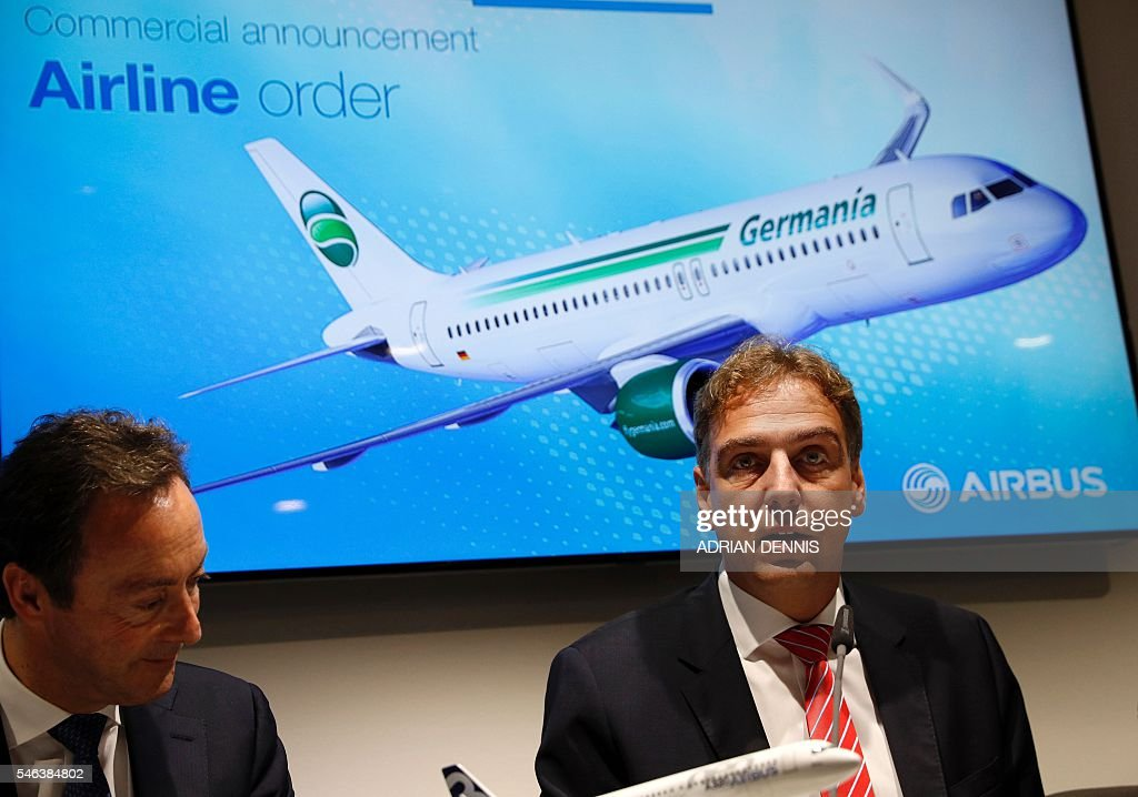 Fabrice Bregier President and CEO of Airbus and Karsten Balke CEO of Germania and SAT address a press conference at the Farnborough Airshow south...