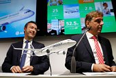 Fabrice Bregier President and CEO of Airbus and Karsten Balke CEO of Germania address a press conference at the Farnborough Airshow south west of...
