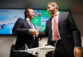 Fabrice Bregier President and CEO of Airbus and Karsten Balke CEO of Germania are pictured as they address a press conference at the Farnborough...