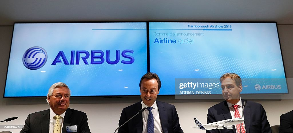 Fabrice Bregier President and CEO of Airbus sits alongside Karsten Balke CEO of Germania and SAT and John Leahy Airbus chief operating officer during...