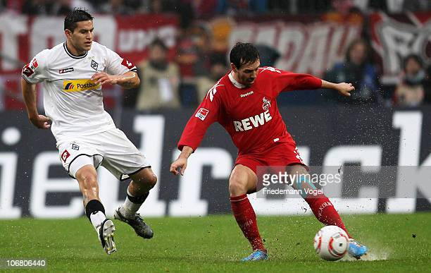 Fabrice Ehret of Koeln and Raul Bobadilla of Gladbach battle for the ball during the Bundesliga match between 1 FC Koeln and Borussia M'gladbach at...