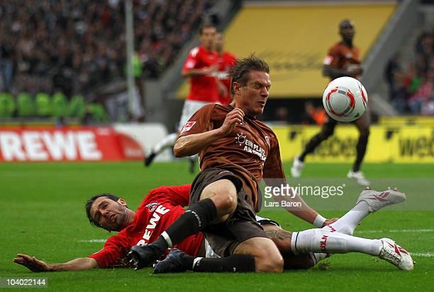 Fabrice Ehret of Koeln challenges Rouwen Hennings of St Pauli during the Bundesliga match between 1 FC Koeln and FC St Pauli at RheinEnergie Stadium...