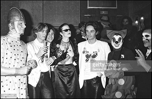 Fabrice Emaer Patrice Calmette and Kenzo dressedup as Mickey mouse with Helmut Berger during a 'Kenzo' party at the Palace night club in Paris in 1979