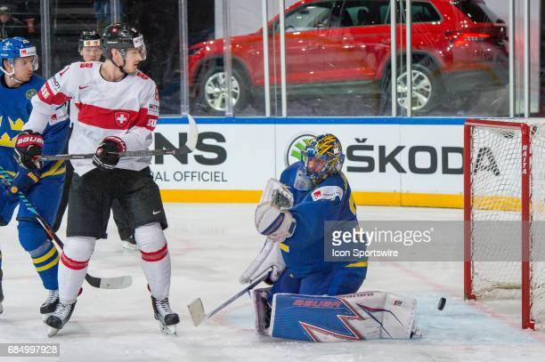 Fabrice Herzog tries to score against Goalie Henrik Lundqvist during the Ice Hockey World Championship Quarterfinal between Switzerland and Sweden at...