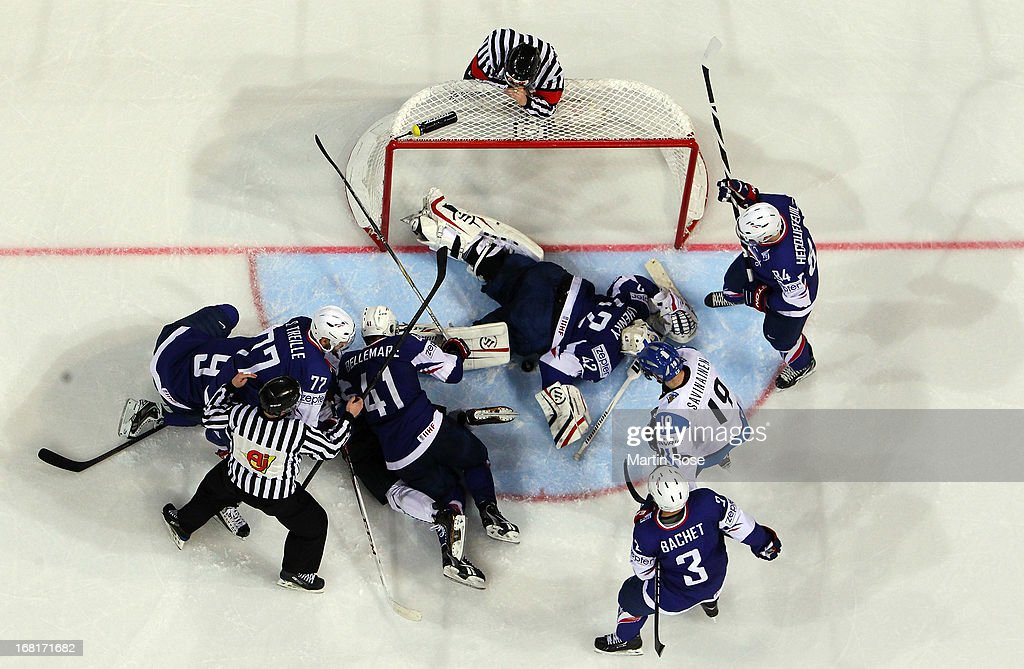 Fabrice Lhenry (#42), goaltender of France covers the puck during the IIHF World Championship group H match between Finland and France at Hartwall Areena on May 6, 2013 in Helsinki, Finland.