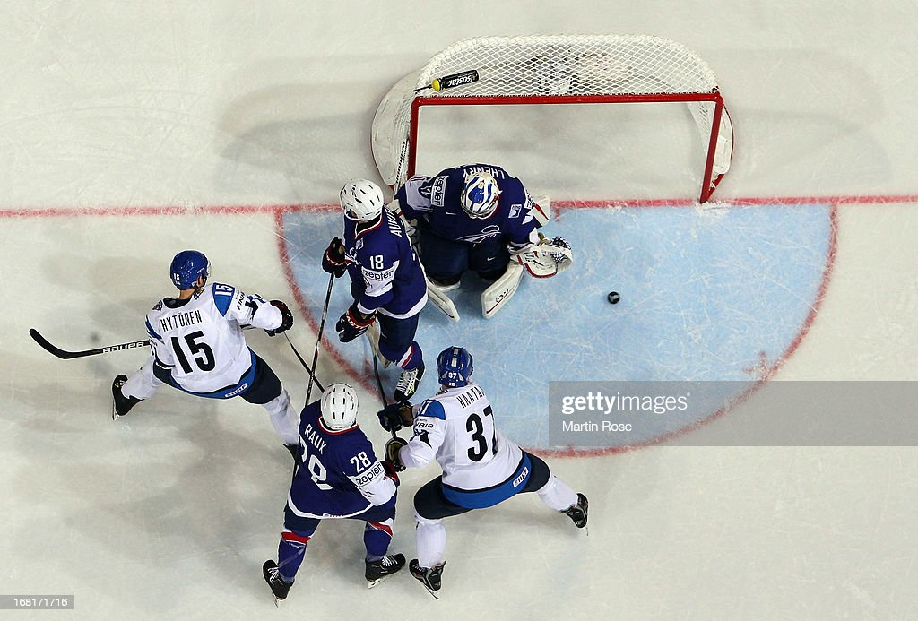 Fabrice Lhenry (#42), goaltender of France makes a save on Juha Haataja (#37) of Finland during the IIHF World Championship group H match between Finland and France at Hartwall Areena on May 6, 2013 in Helsinki, Finland.