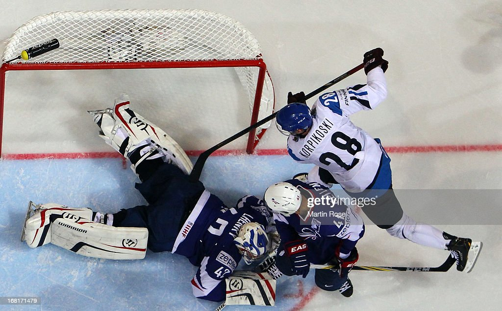 Fabrice Lhenry (#42), goaltender of France makes a save on <a gi-track='captionPersonalityLinkClicked' href=/galleries/search?phrase=Lauri+Korpikoski&family=editorial&specificpeople=2108074 ng-click='$event.stopPropagation()'>Lauri Korpikoski</a> (#28) of Finland during the IIHF World Championship group H match between Finland and France at Hartwall Areena on May 6, 2013 in Helsinki, Finland.