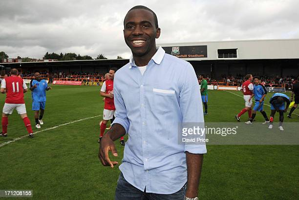 Fabrice Muamba manager of the World Refugee Internally Displaced Persons XI smiles during the charity football match between Arsenal Legends XI and...